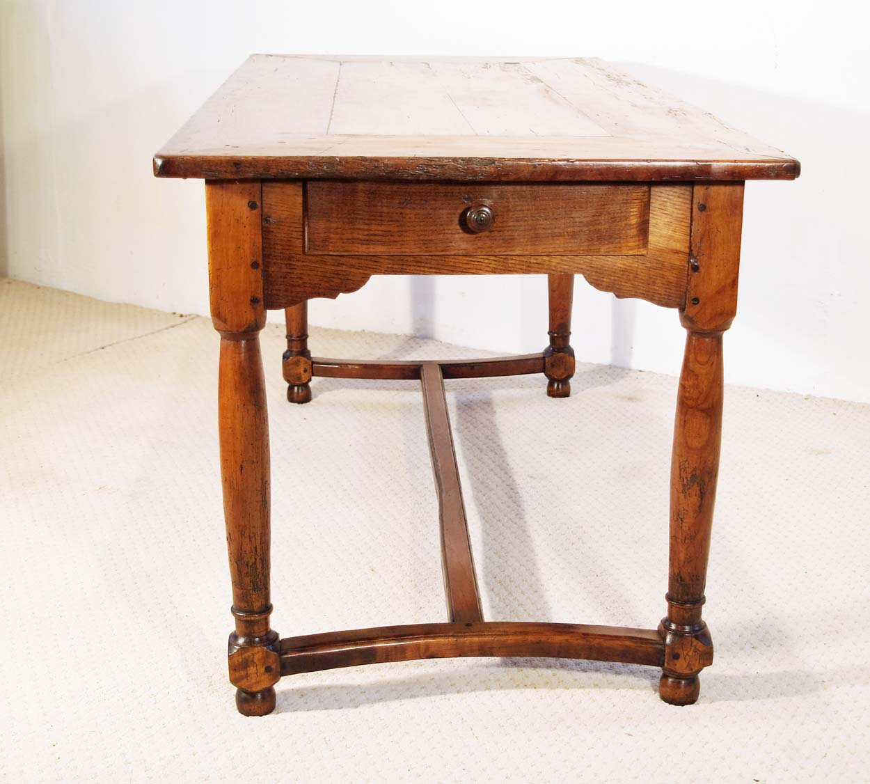 French Antique Cherry Farmhouse Table with Crinoline Stretchers C 1790, end elevation