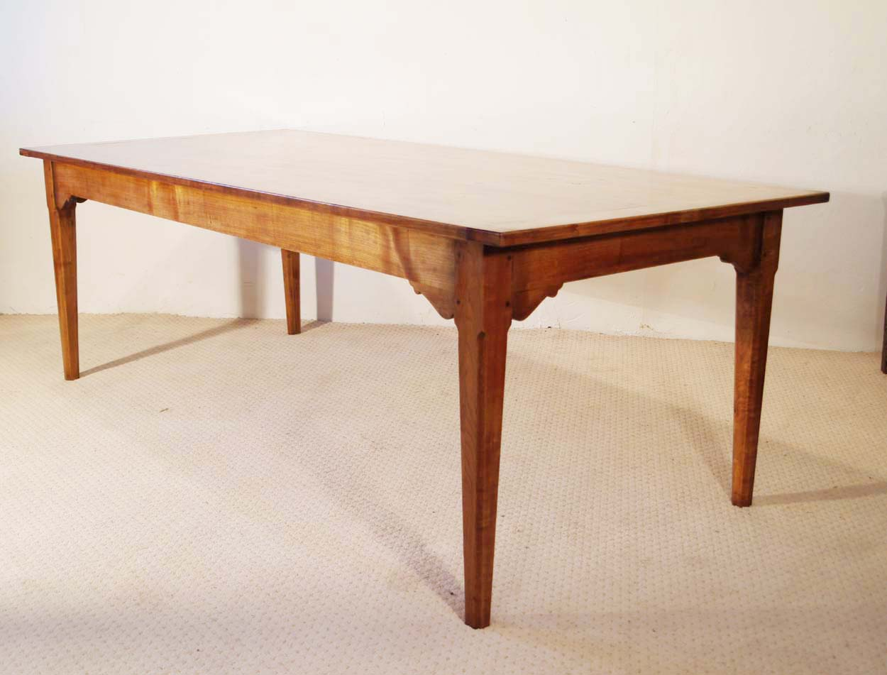 French antique style cherry table with bracketed frame