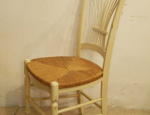 8 French vintage painted chairs with rush seats.